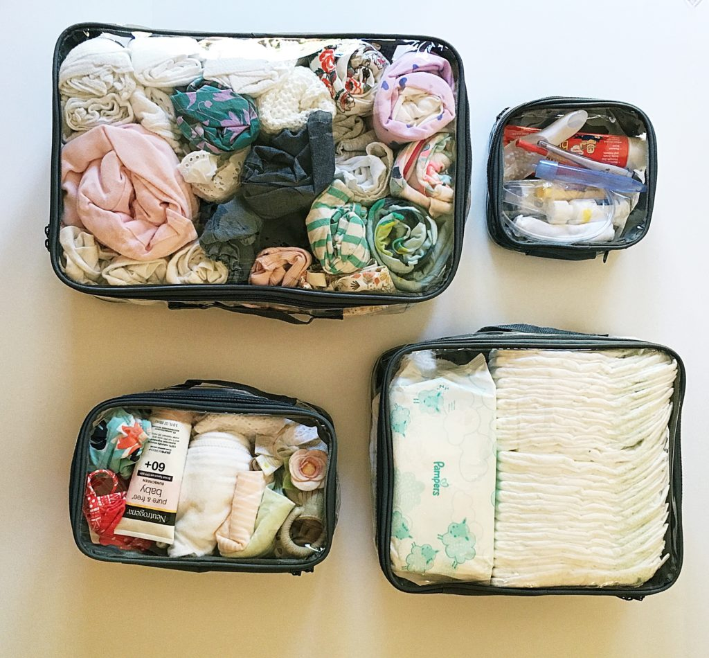 Baby essentials organized in packing cubes