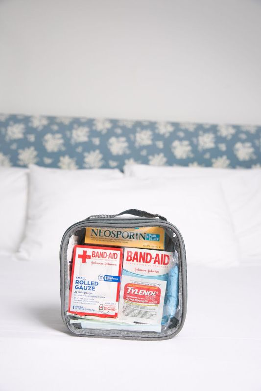 Band aid, neosporin, and ther first aid kit essentials you need in your college dorm