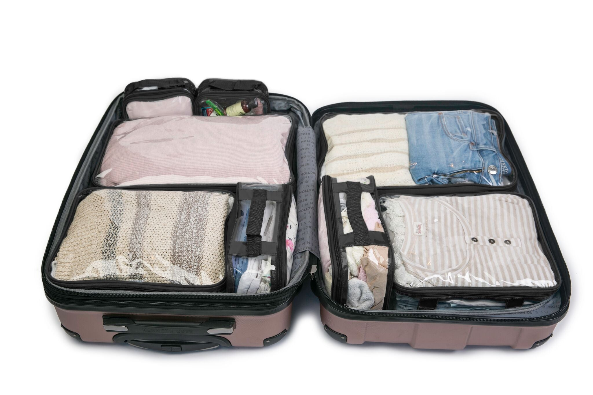 Black packing cubes inside suitcase