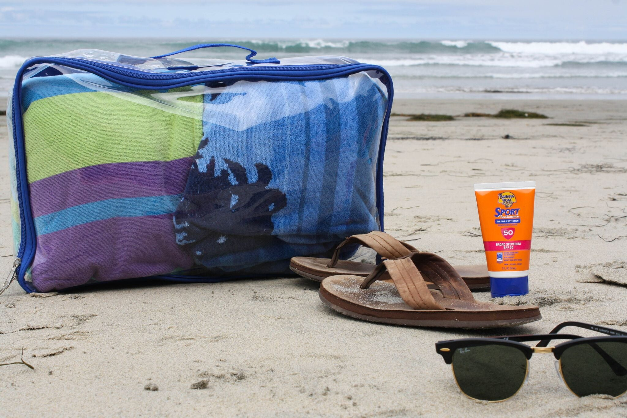 Blue large packing cube as a beach tote bag