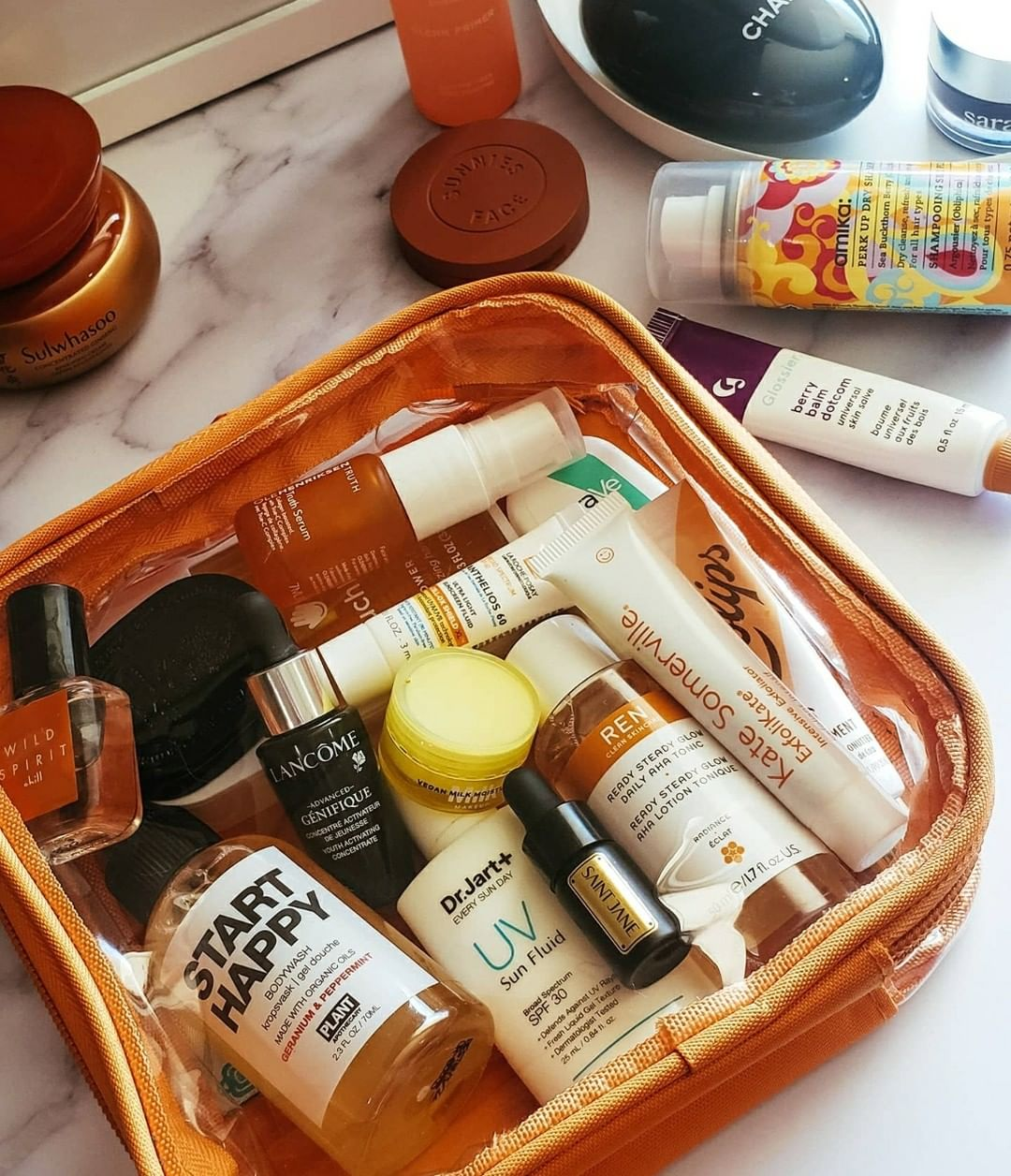 Travel size bottles packed in an orange TSA Approved Toiletry Bag