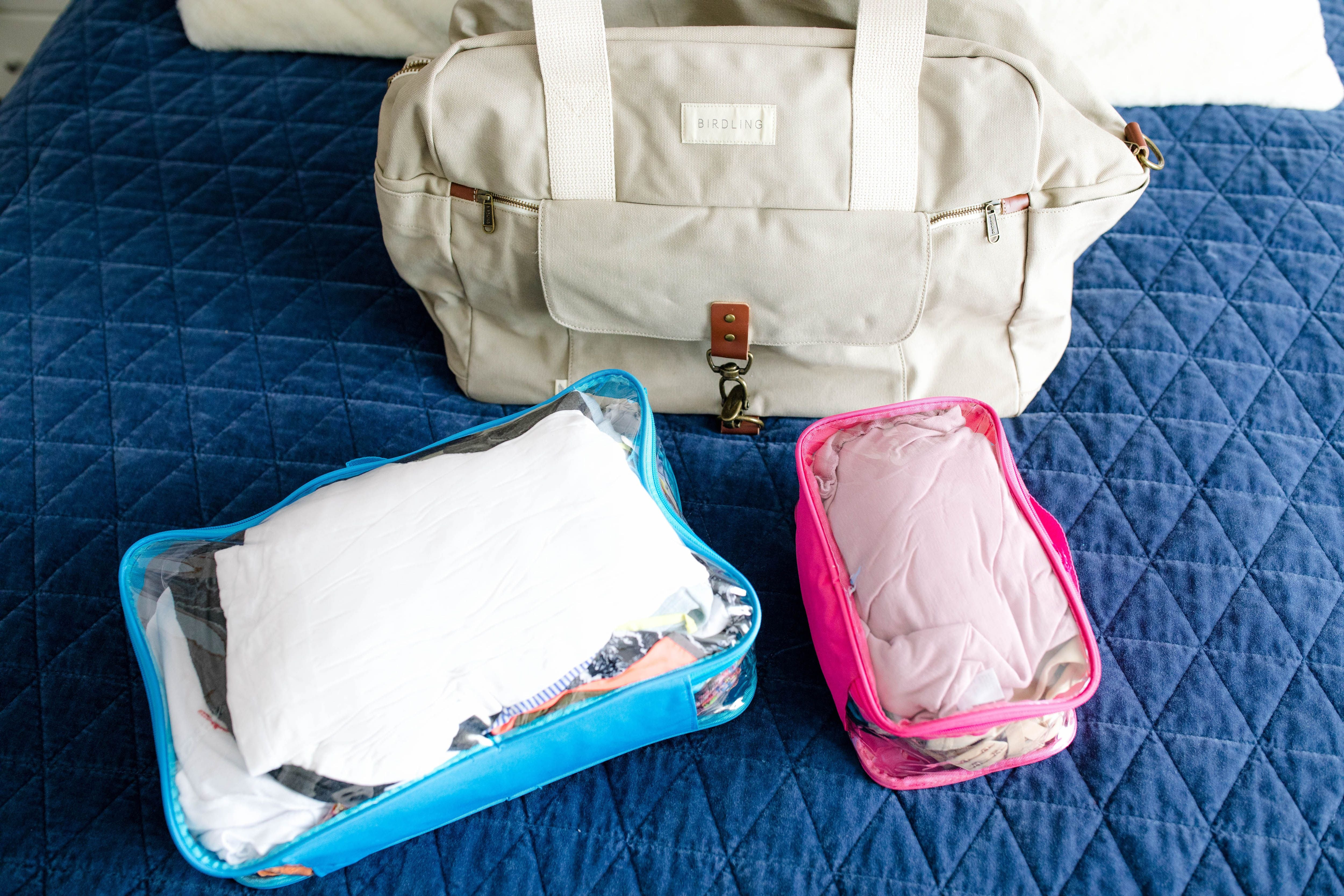 Clear packing cubes and duffel bag for an overnight trip