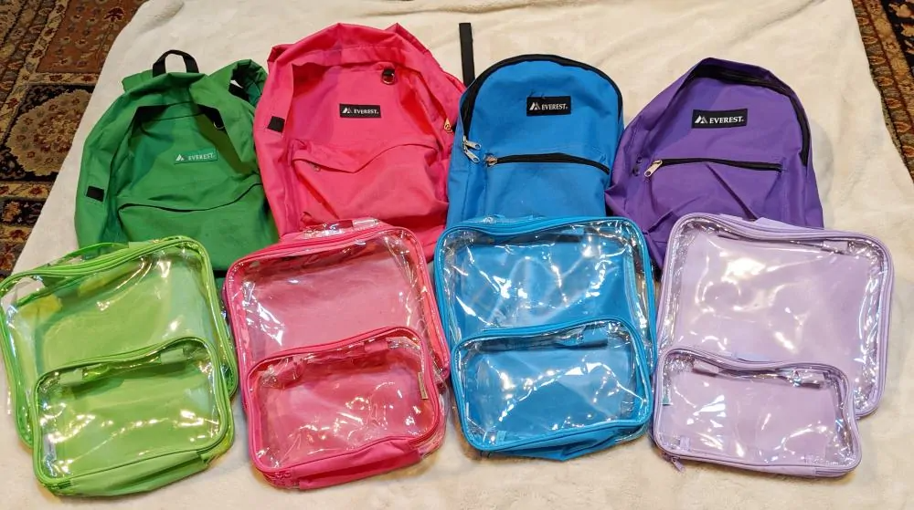 Clear packing cubes and backpacks with matching colors