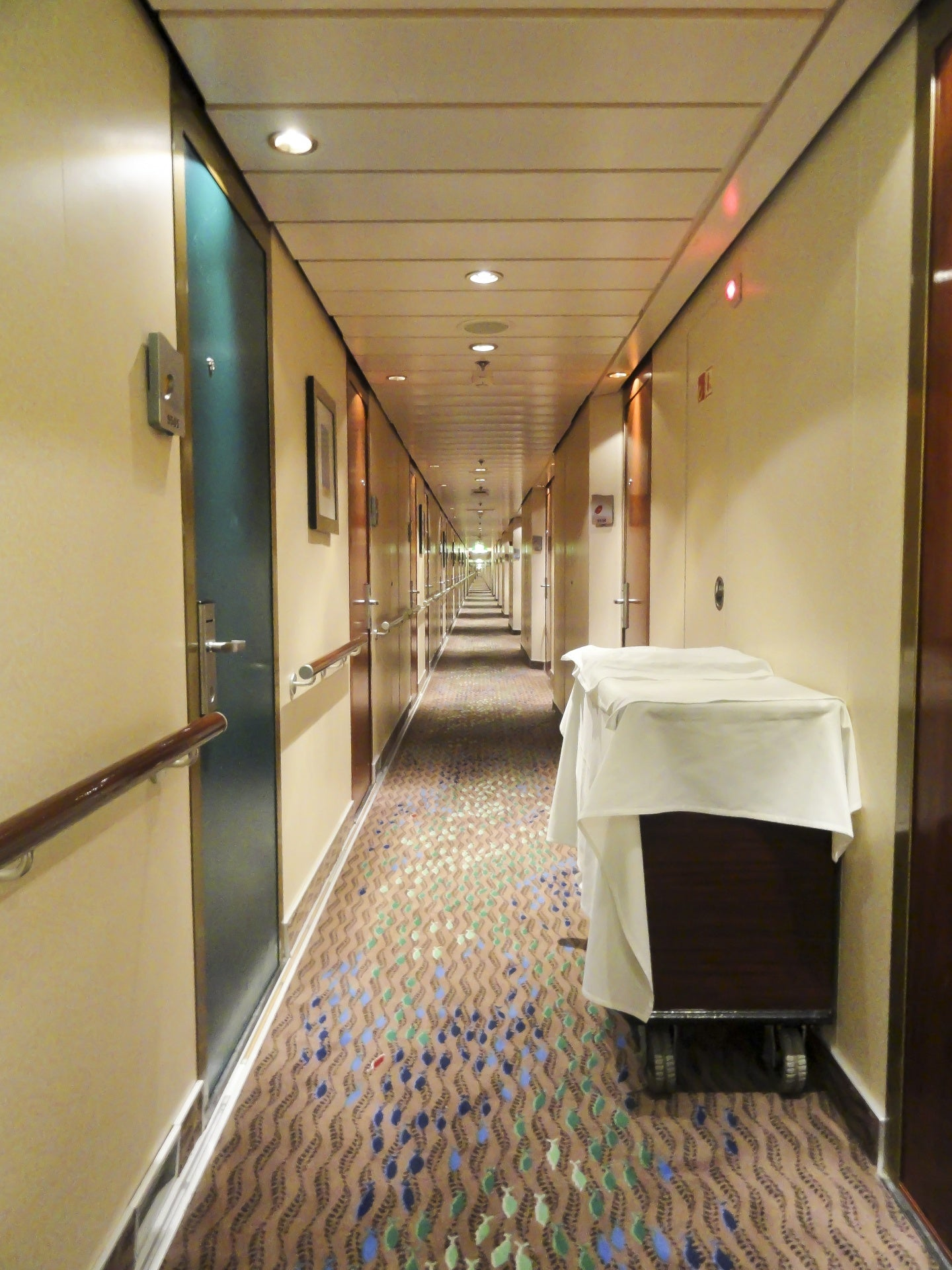 Different cabin doors on cruise hallway
