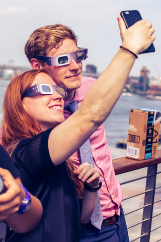 Techie newlywed with 3D eye mask taking selfie using smartphone