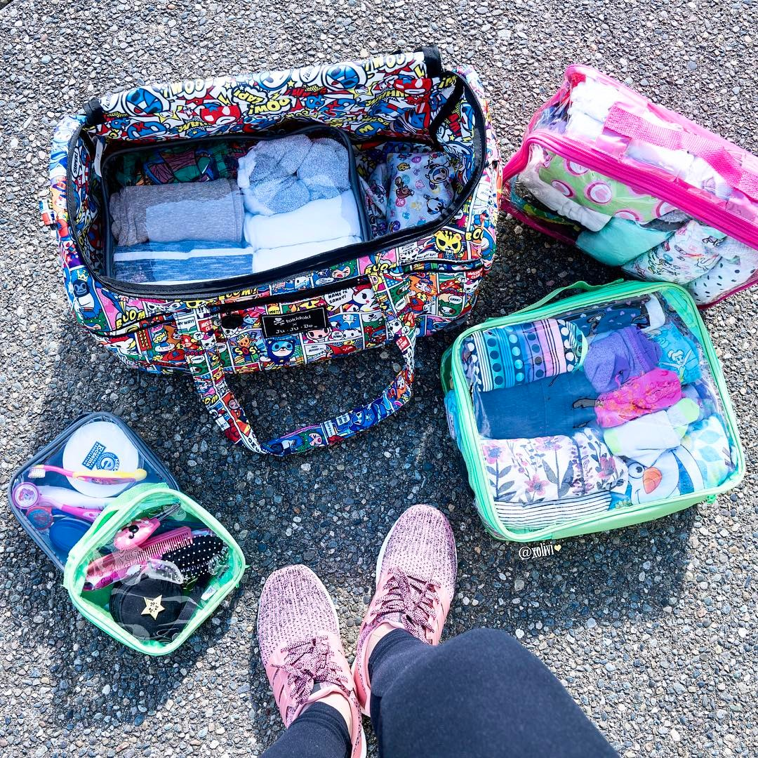Diaper bag organized with travel cubes