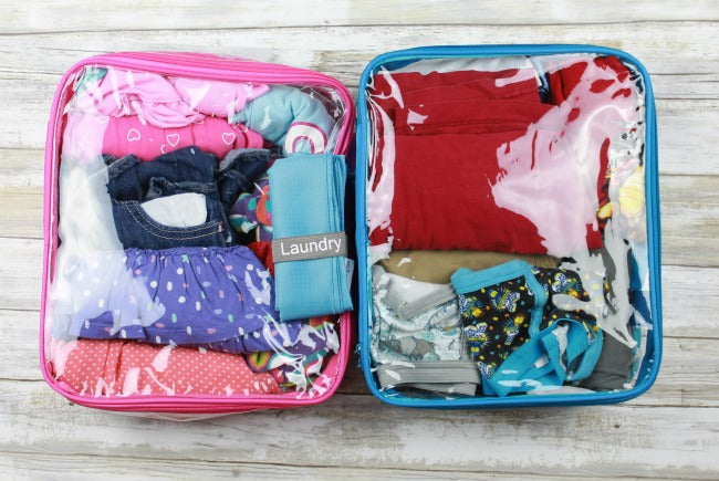 Packing cubes in pink and blue for an organized suitcase