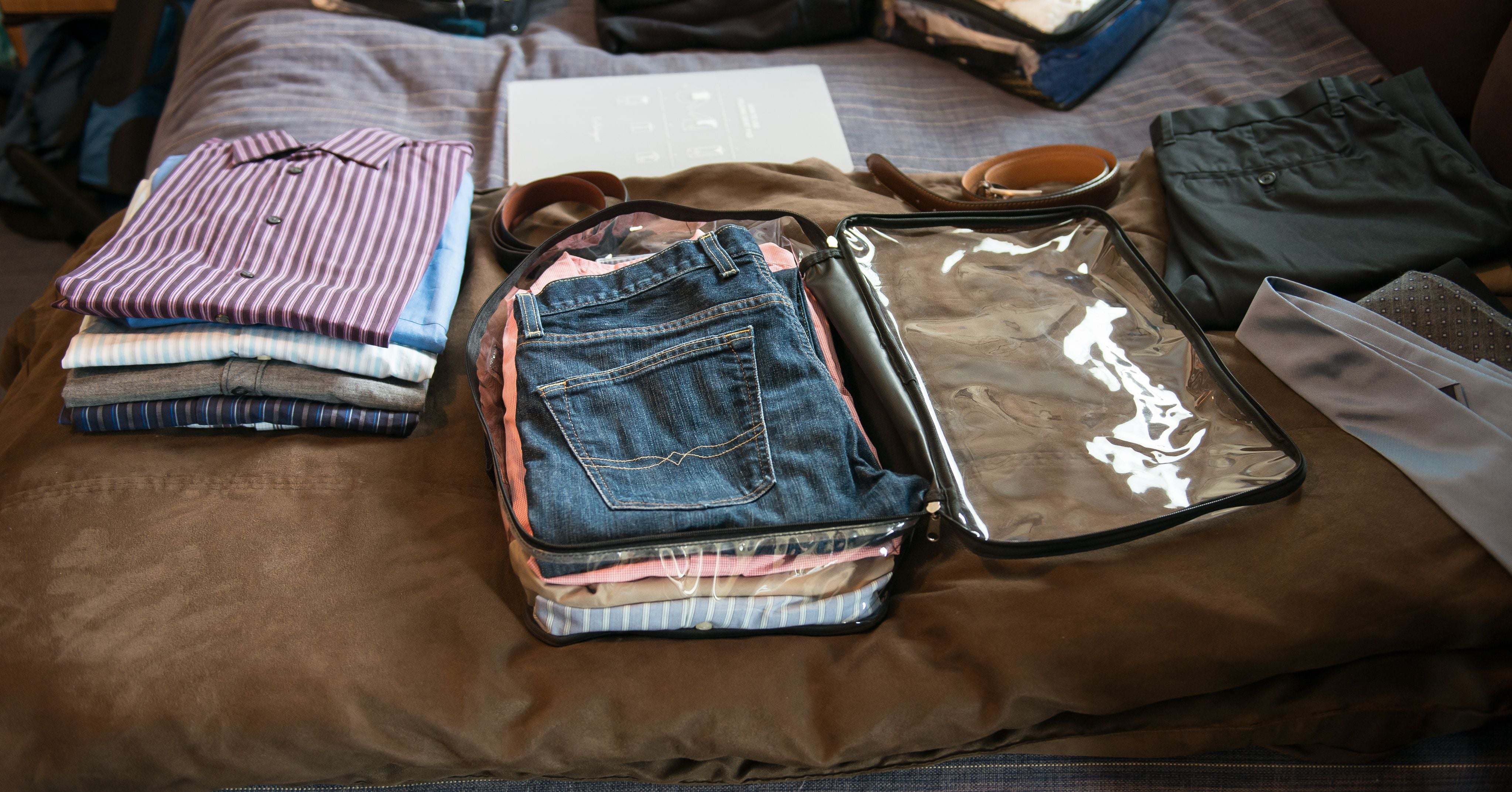 Folded pants in a clear packing cube