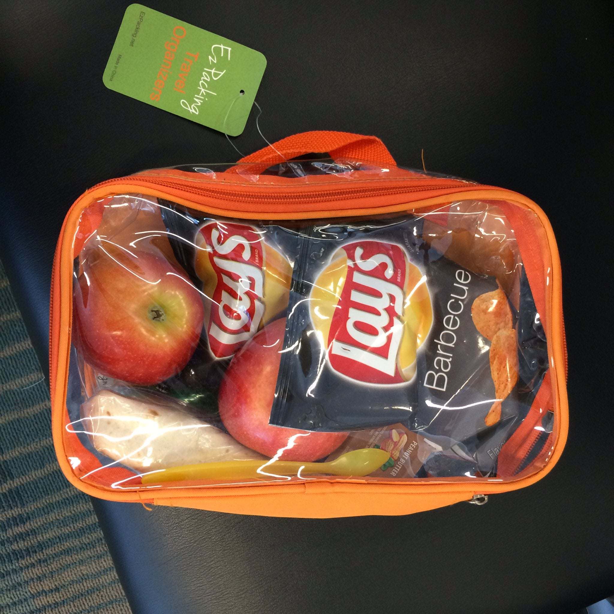 Fruits and chips in an orange small cube