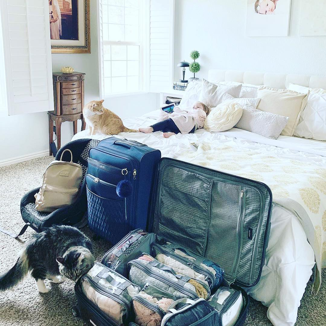 Fully packed luggage in a bedroom