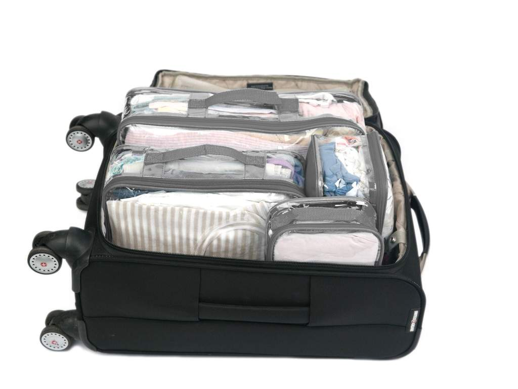Clear packing cubes packed in a suitcase