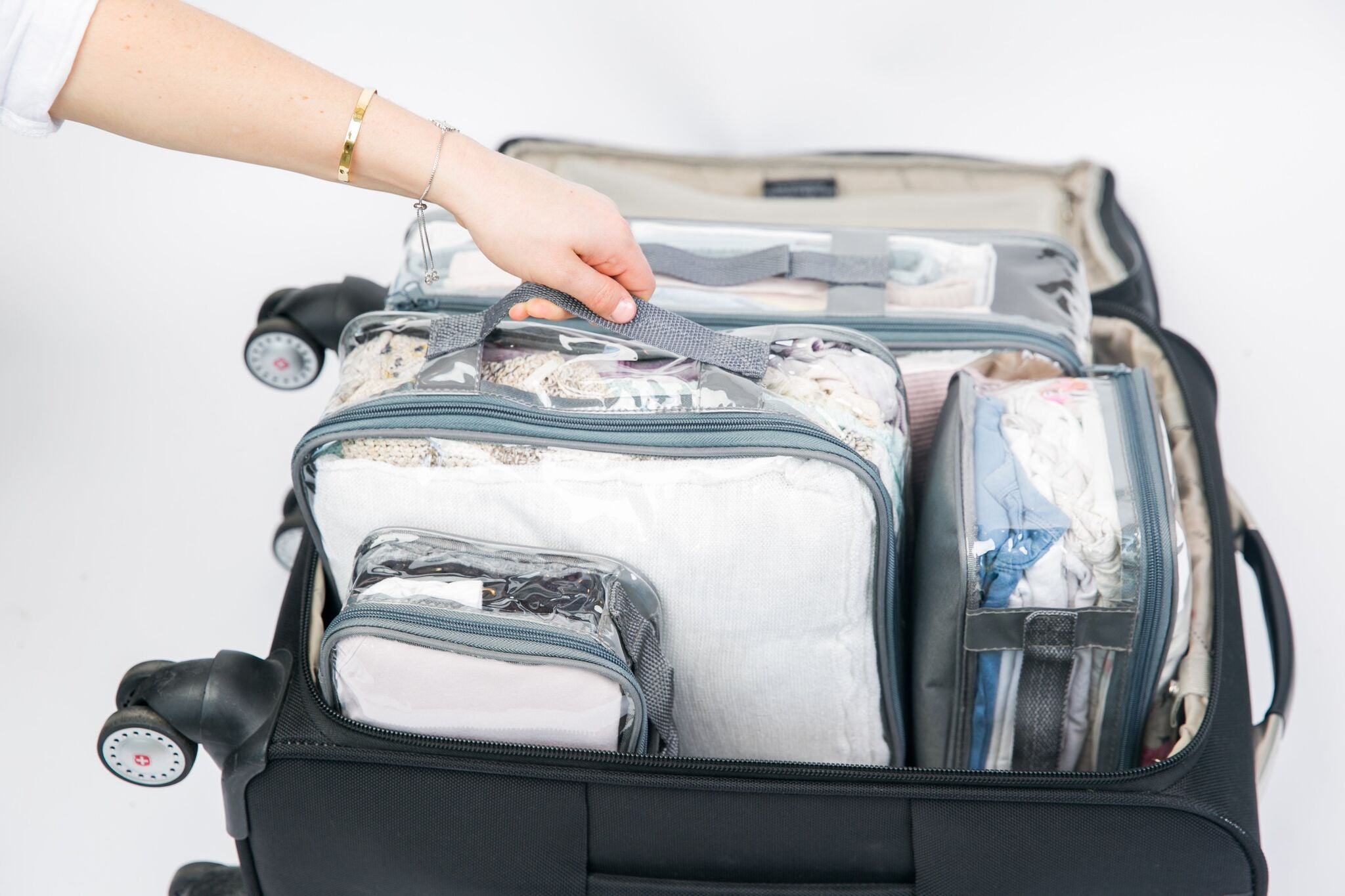 Gray packing cubes in suitcase