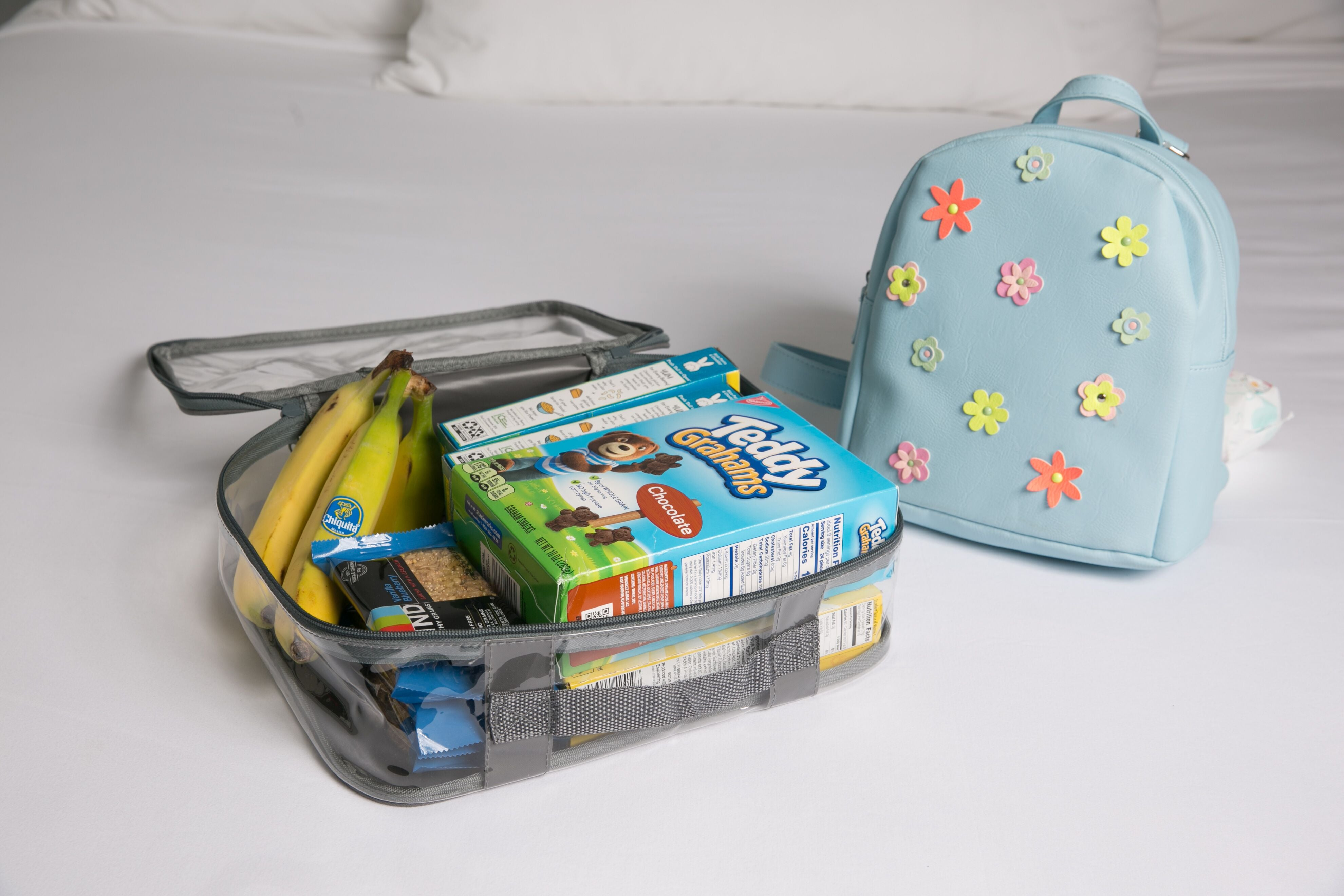Kids snacks for backpacking trip in a clear packing cube