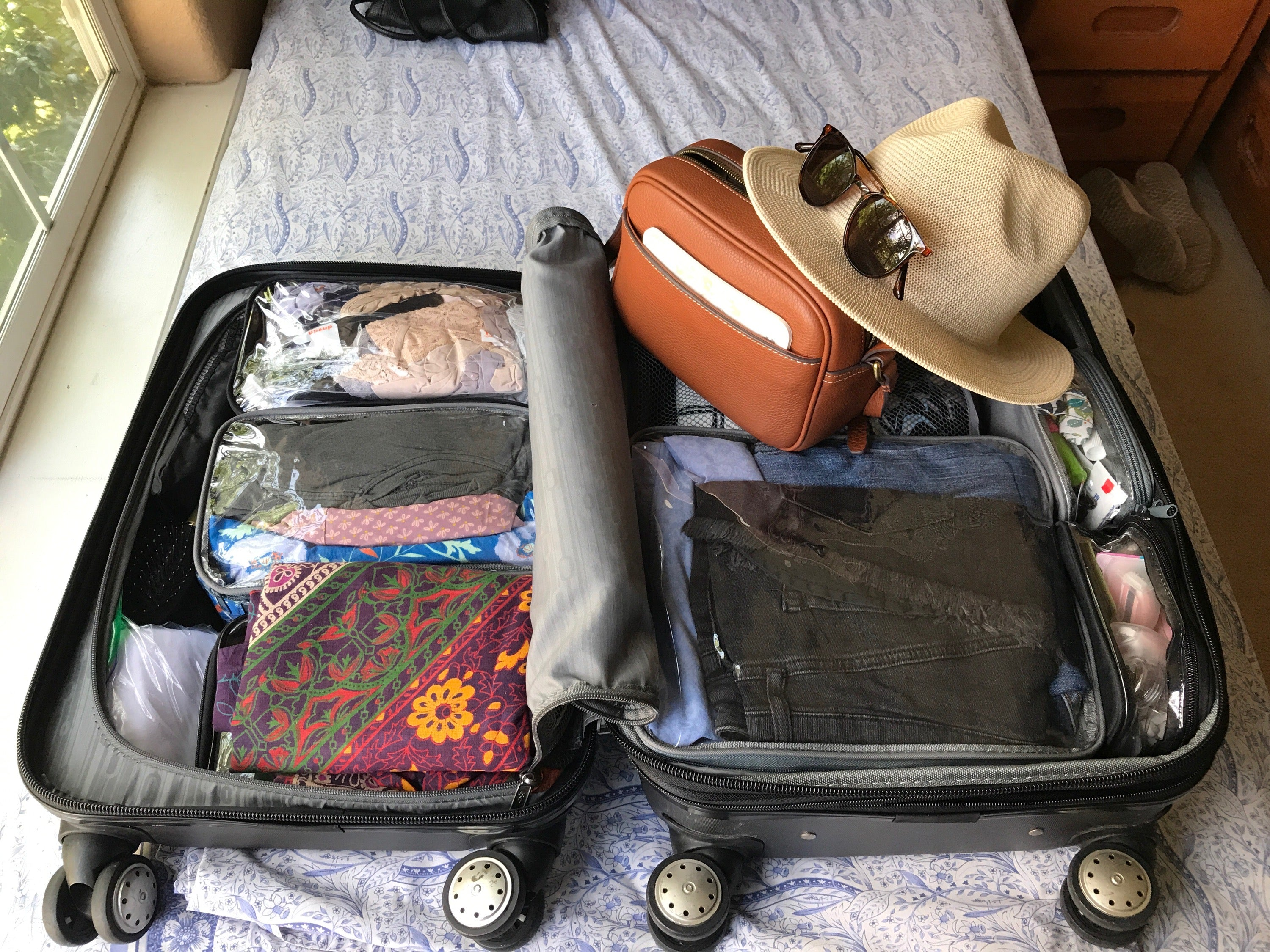 My carry on suitcase for 2 months of traveling through Europe in the summer! I took 1 Medium Cube, 2 Small Cubes, and 3 Extra Small cubes. It was perfect!