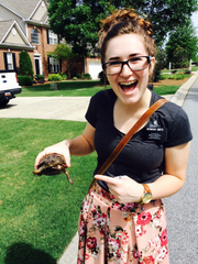 Jesse holding a turtle during her missionary trip