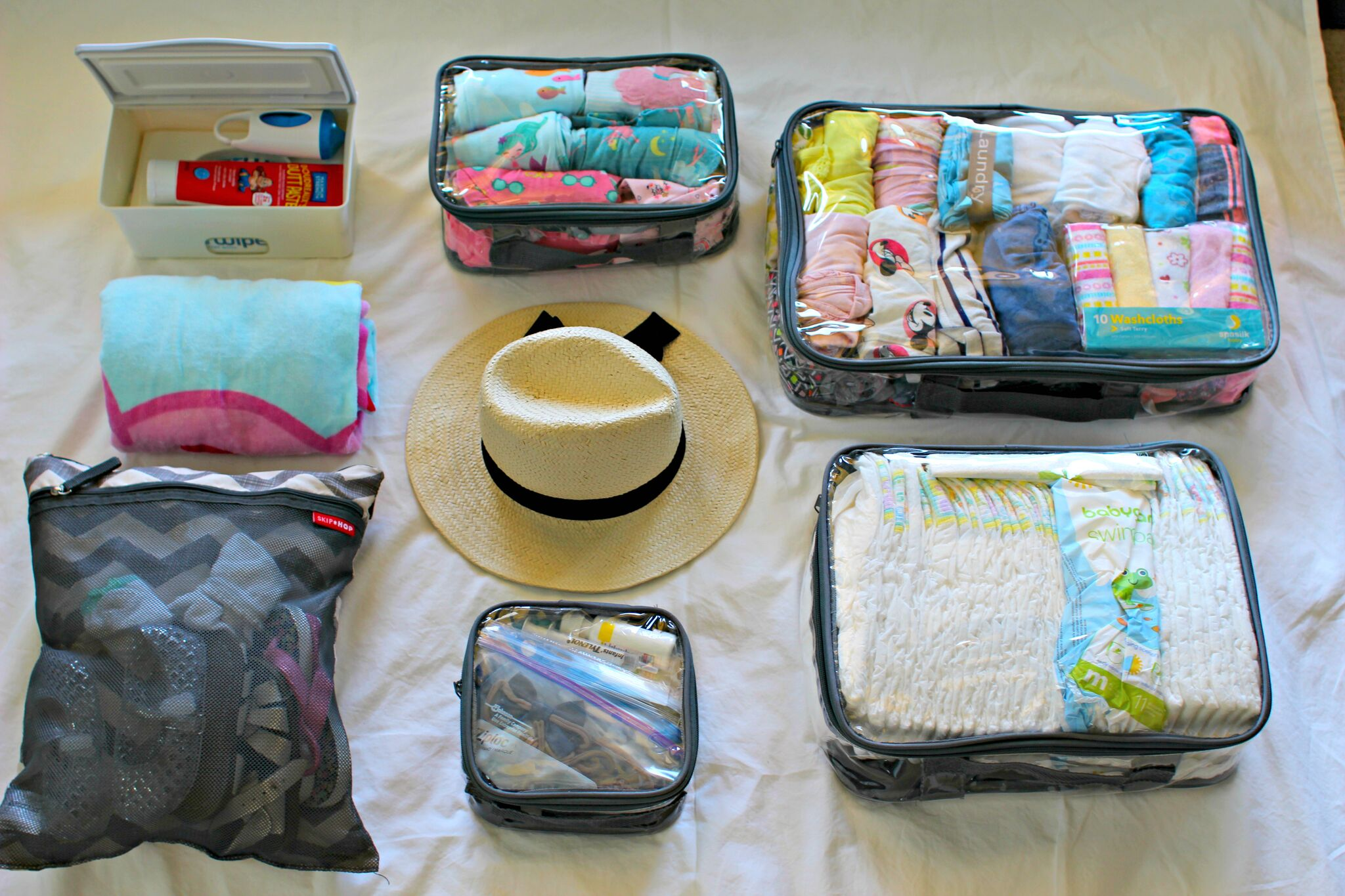 Kid's travel items organized using packing cubes