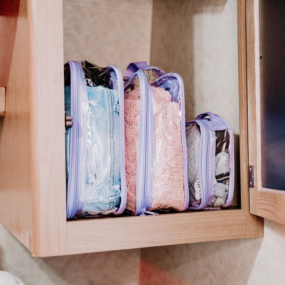 Lilac Packing Cubes in a small RV cabinet