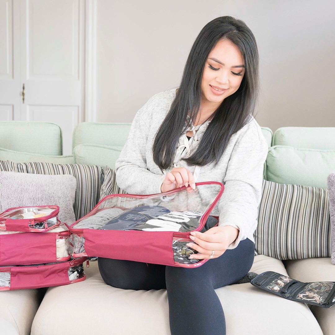 Lady packing with her burgundy clear cubes