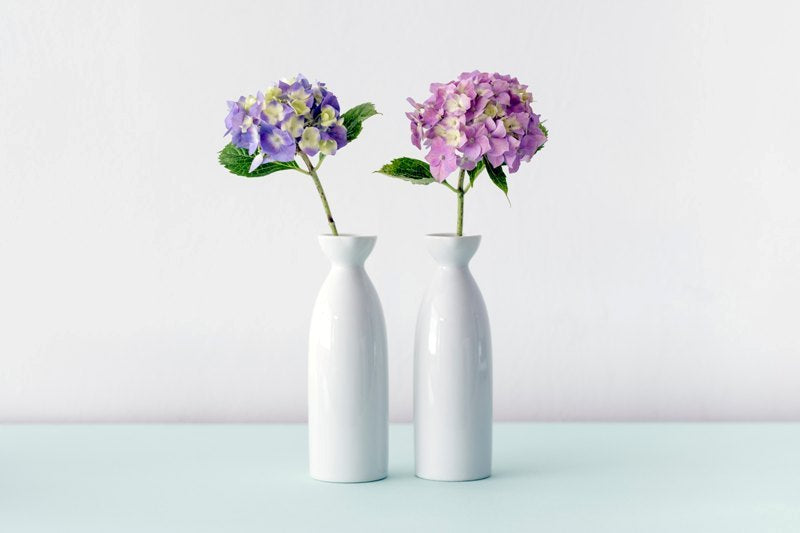 Simple-looking vases with purple and pink flowers