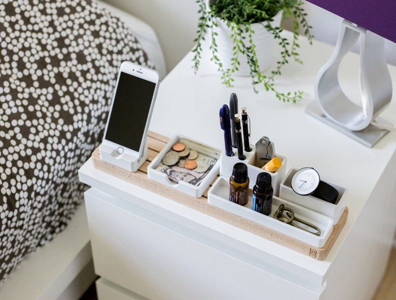 Bedside organizer with phone, money, pens and watch that extremely organized individuals use