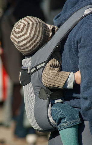 Mom carrying lap baby using carrier