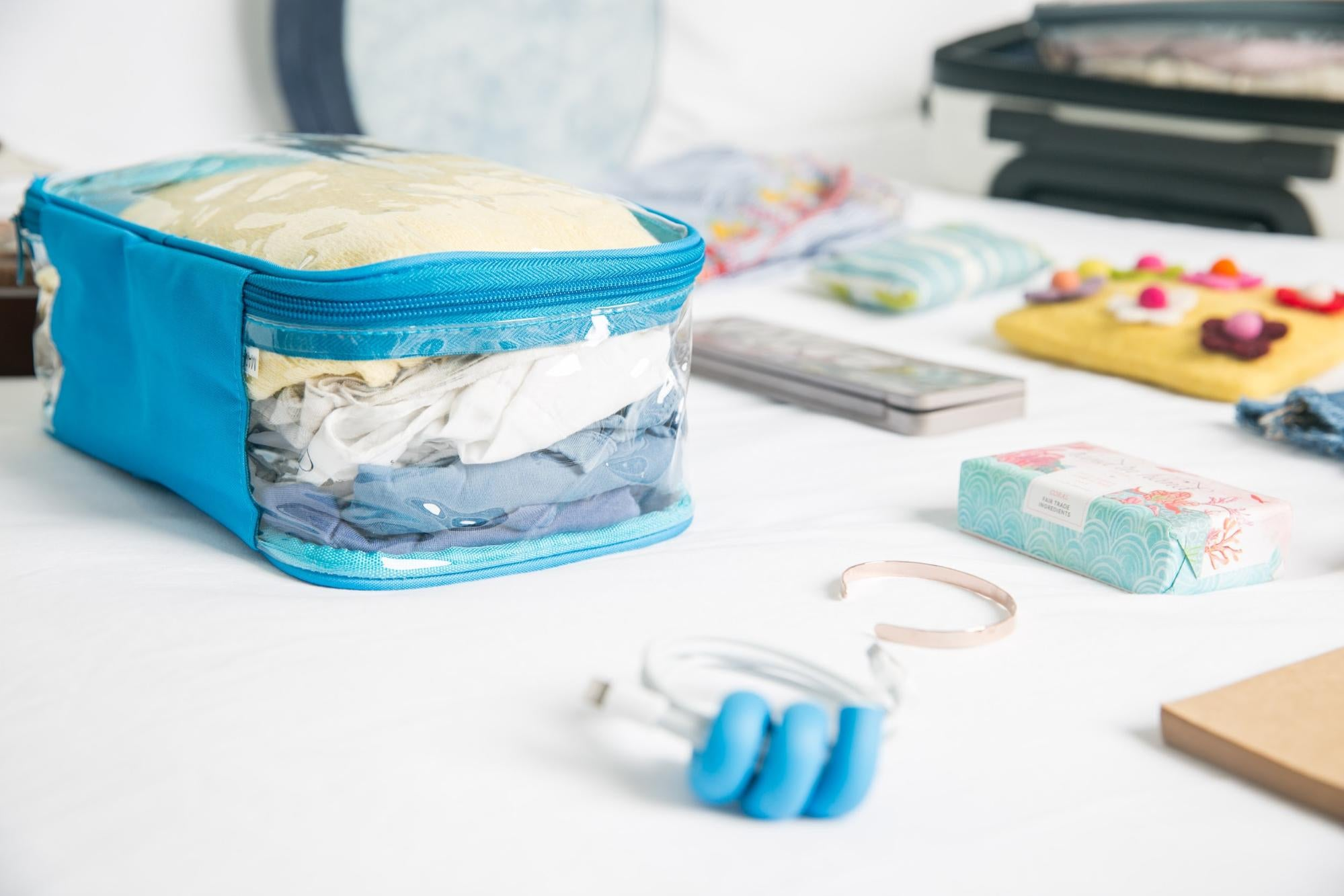 Blue EzPacking cube with essentials for Disneyland vacation trip