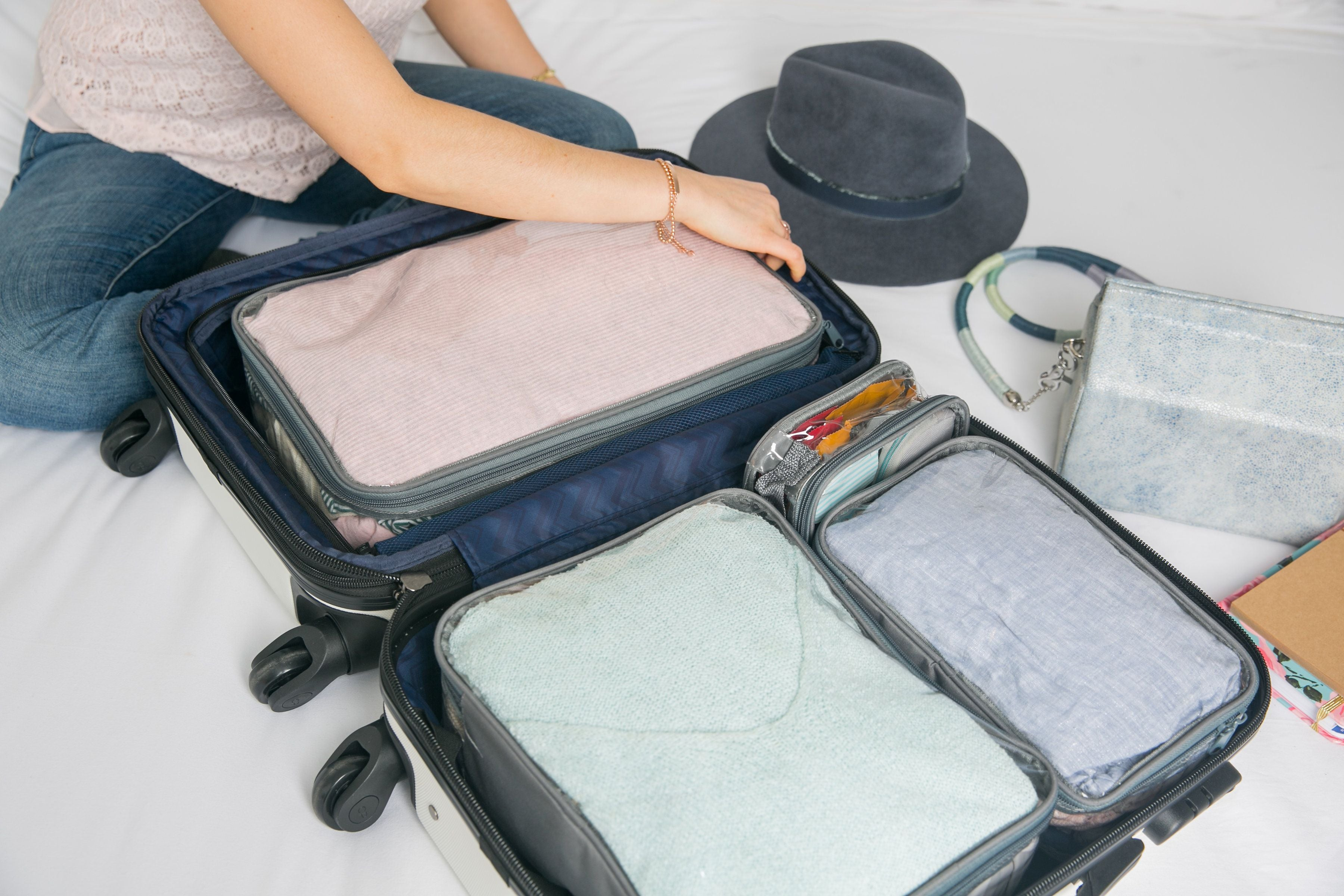 Packing a carry on suitcase using starter set packing cubes