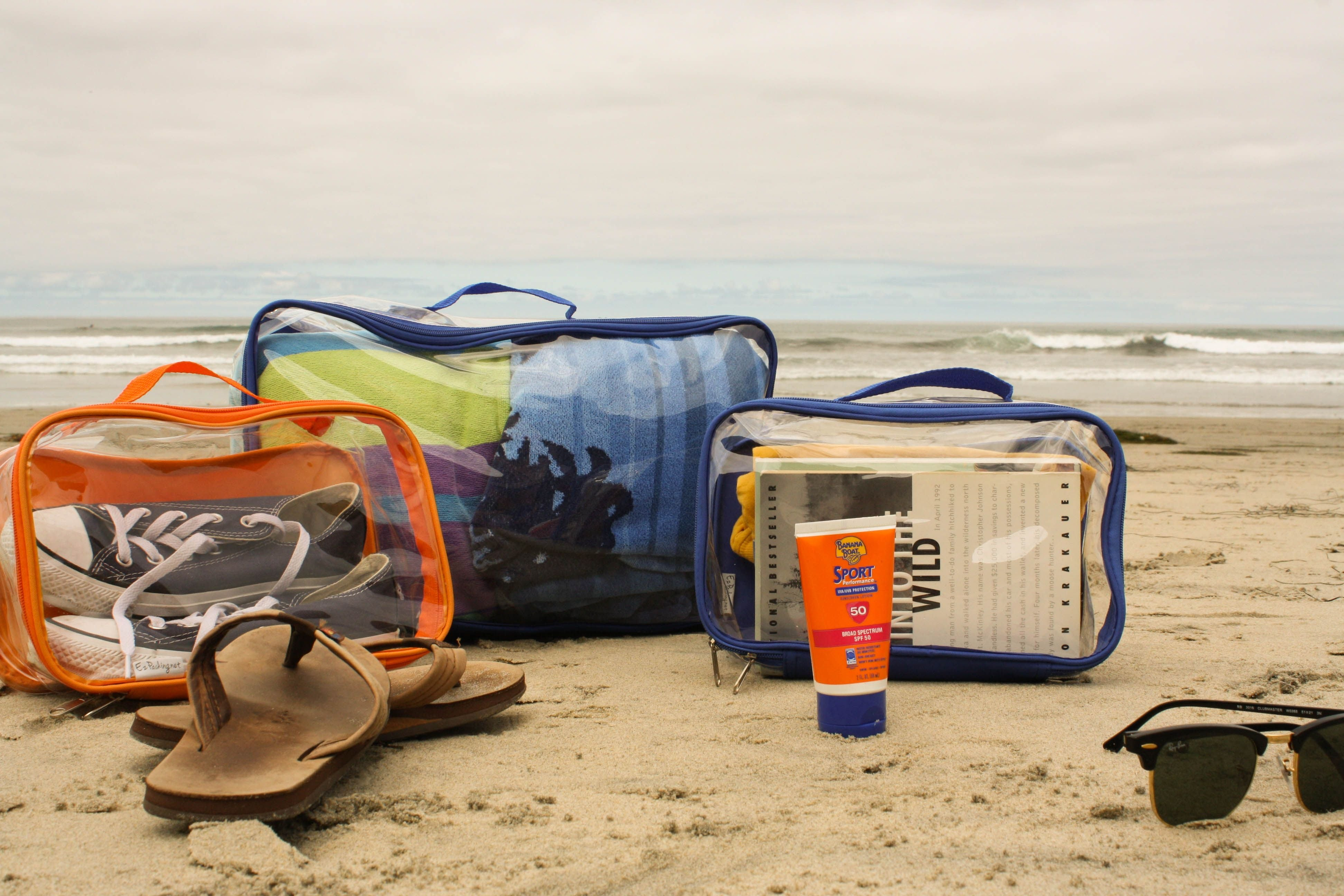 Beach essentials packed in clear packing cubes