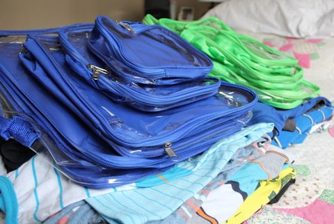 Blue and green packing cubes for packing kids' suitcase