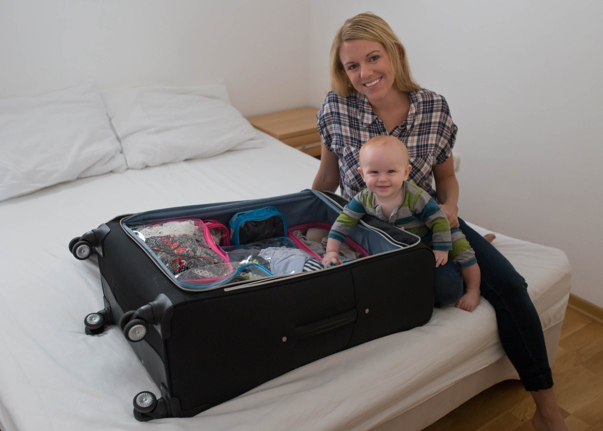 Mommy and baby packing for trip with Complete Bundle