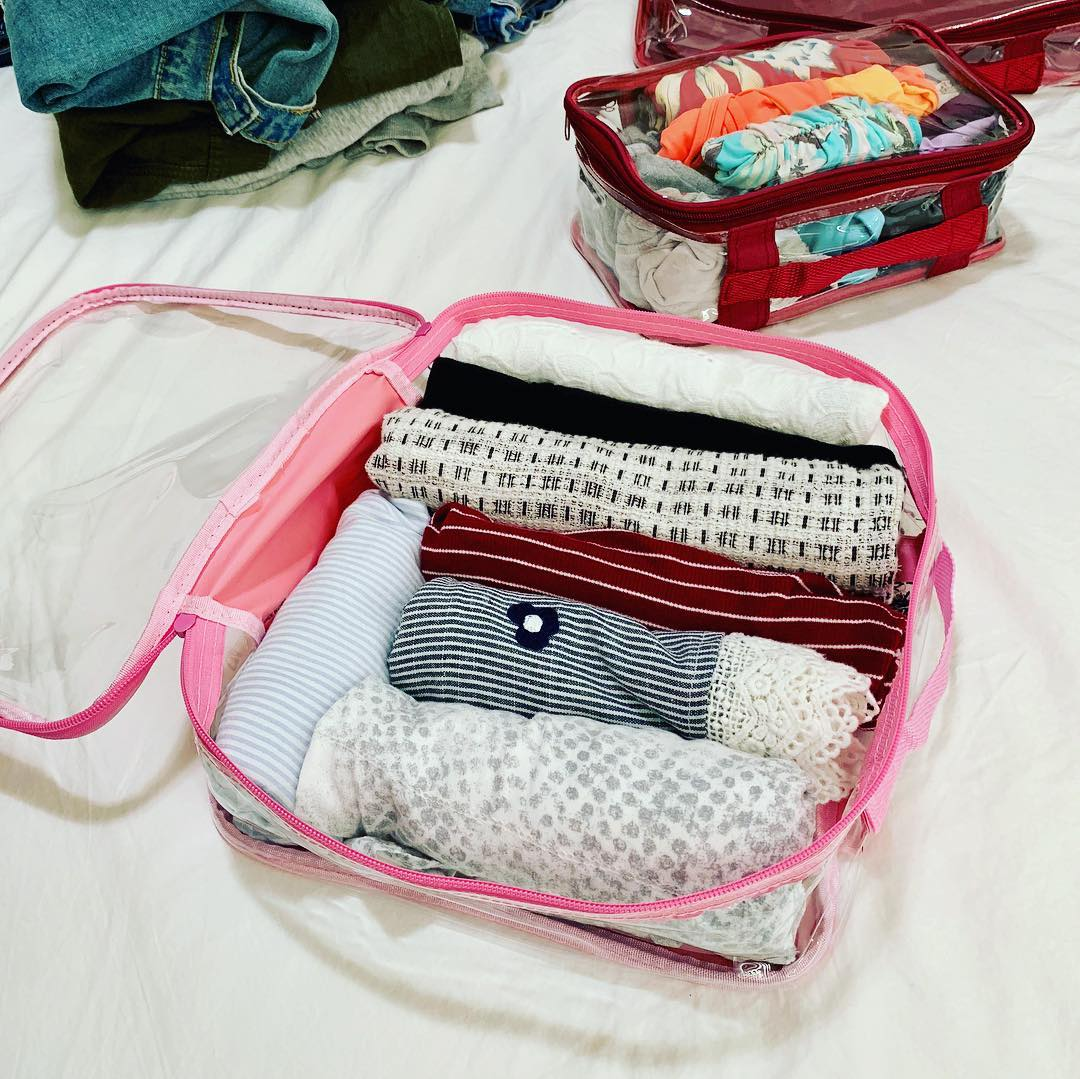 Rolled clothes packed in clear cubes