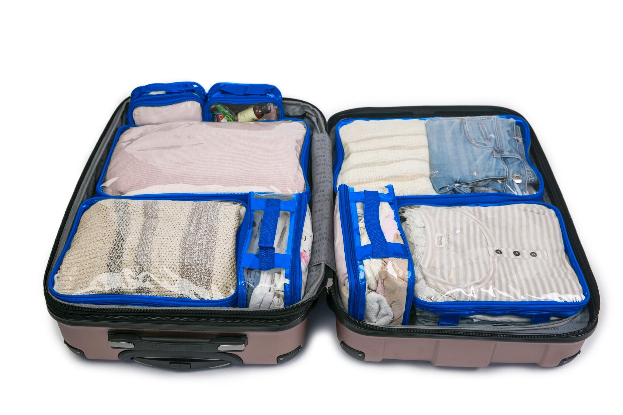 Royal blue packing cubes inside pink suitcase