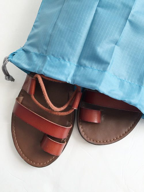 Sandals in a travel shoe bag for camping trip