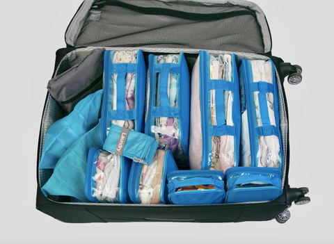 Organized suitcase using blue packing cubes