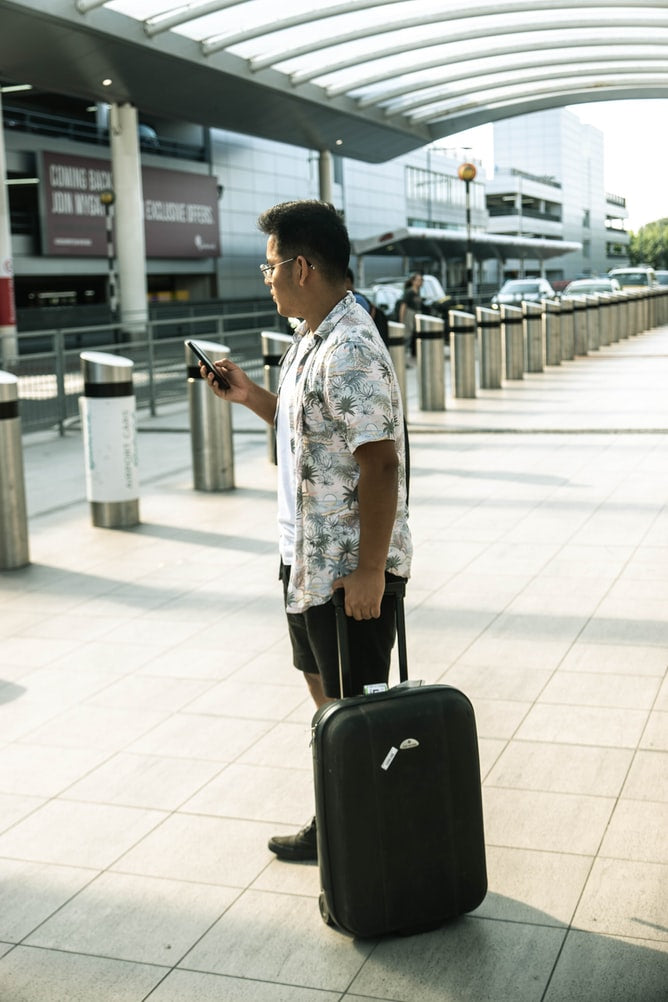 Man with suitcase on airport