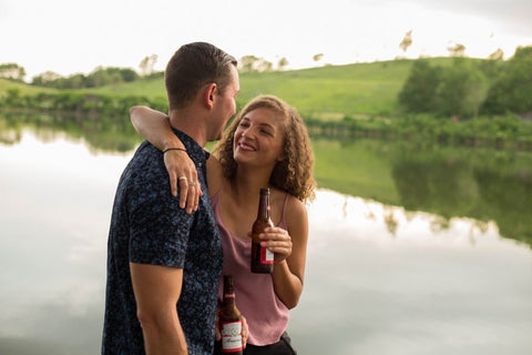 Newlywed couple enjoying partying and drinking together