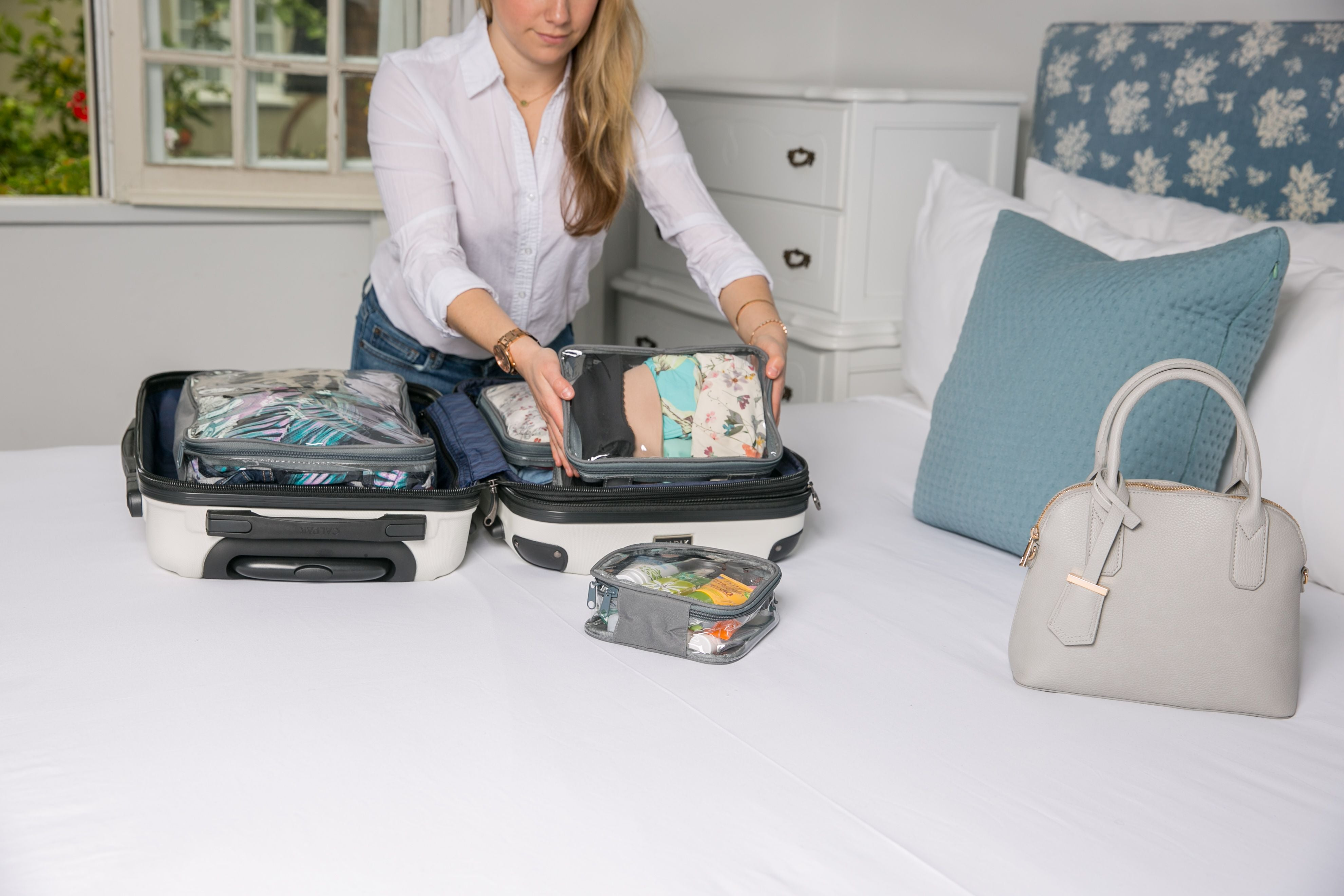 Tali packing starter set cubes in a carry on suitcase