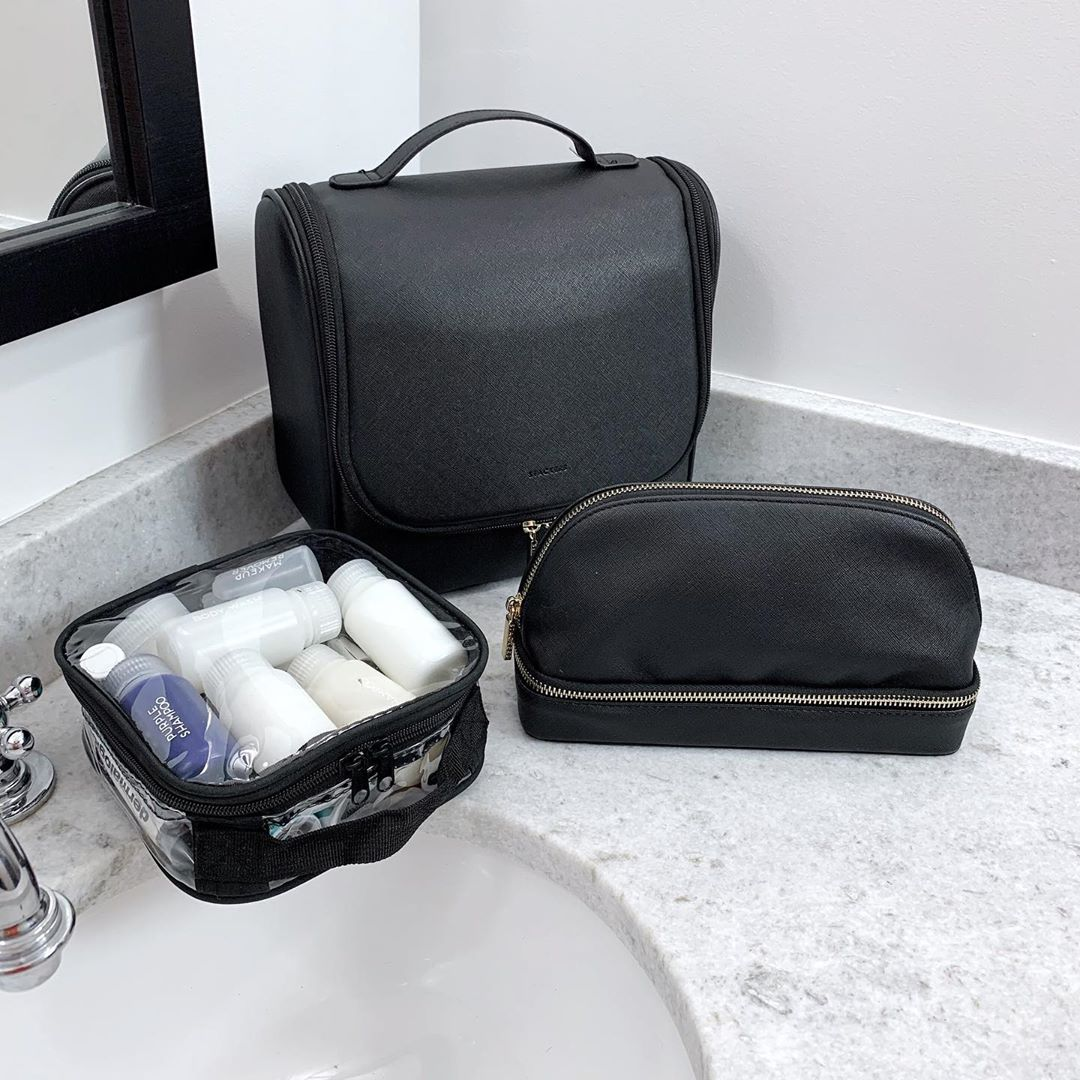 Different travel toiletry bags on toilet counter