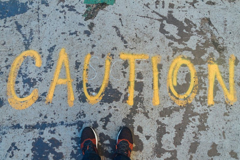 "Ground with large spray painted ""Caution"""