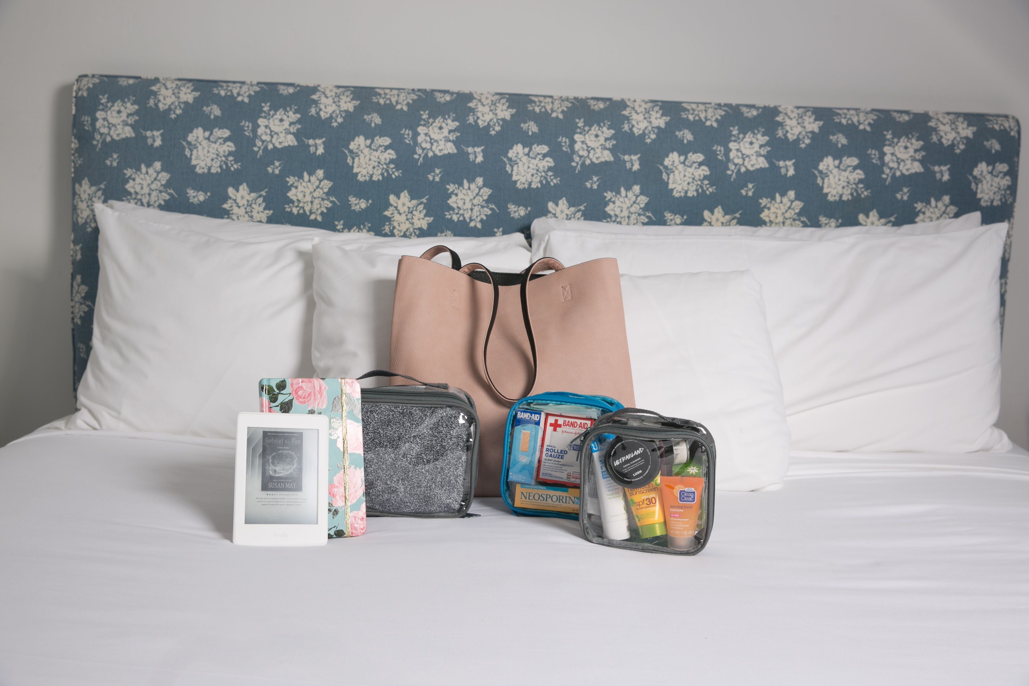 Tote bag and overnight trip essentials in clear packing cubes