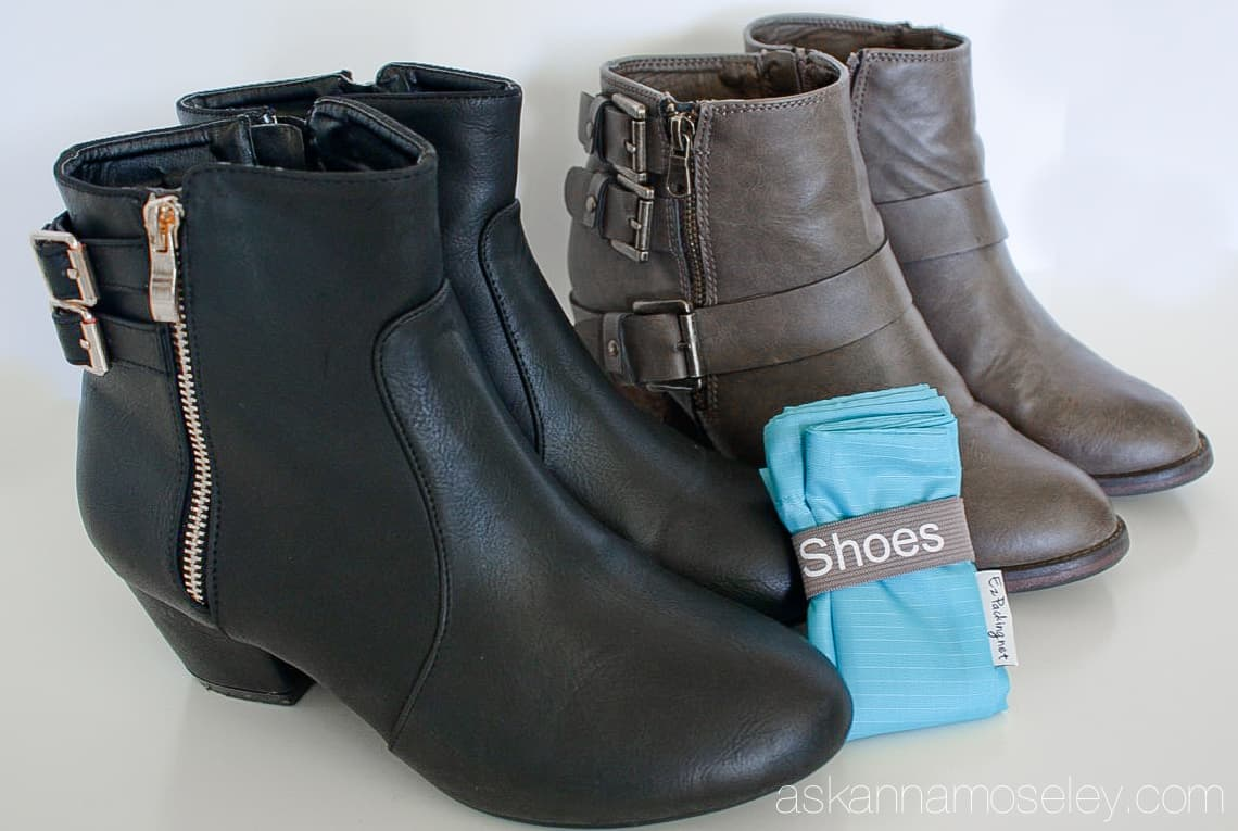 Two pairs of boots and a folded travel shoe bag