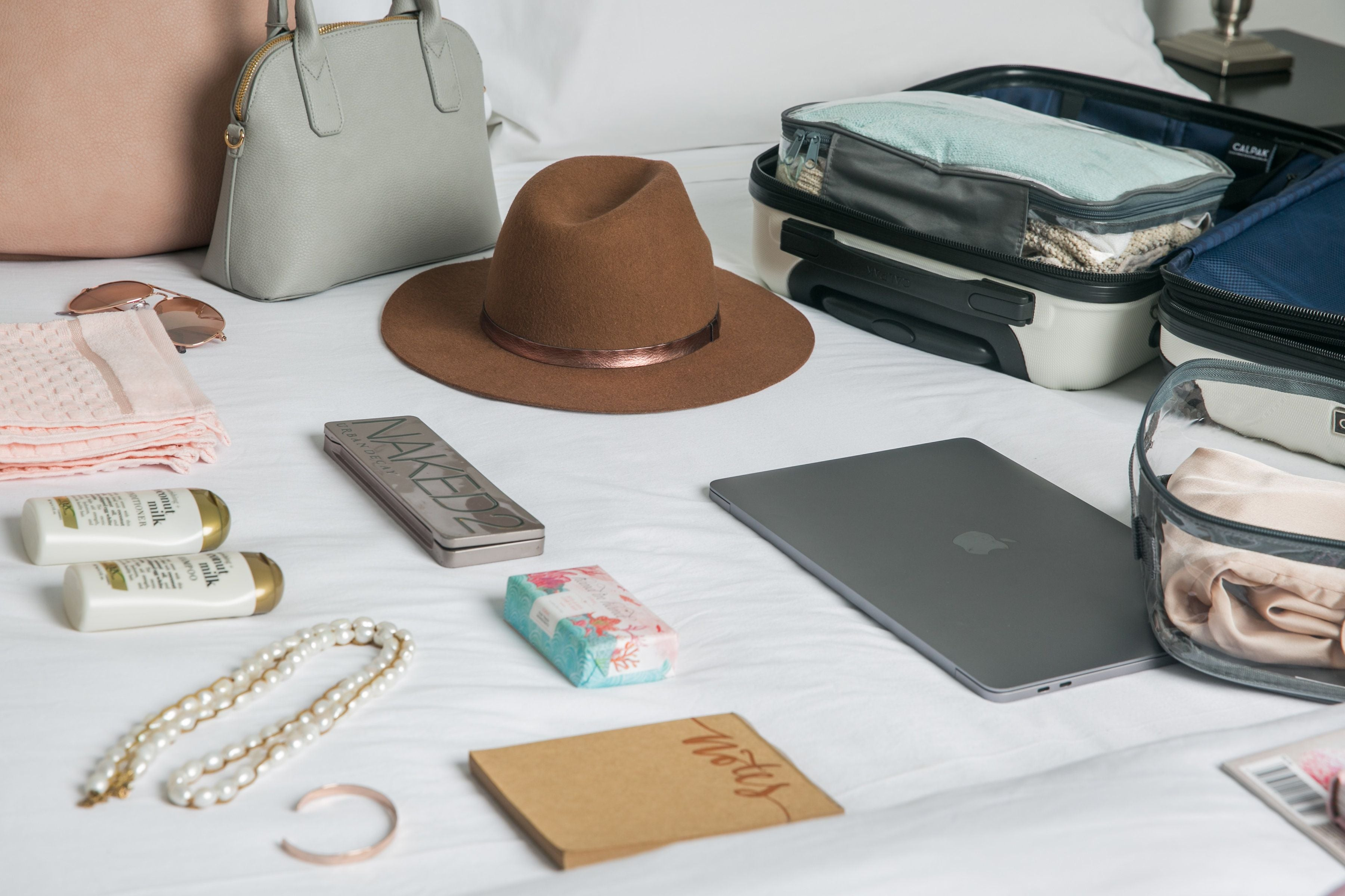 Travel essentials laid on the bed