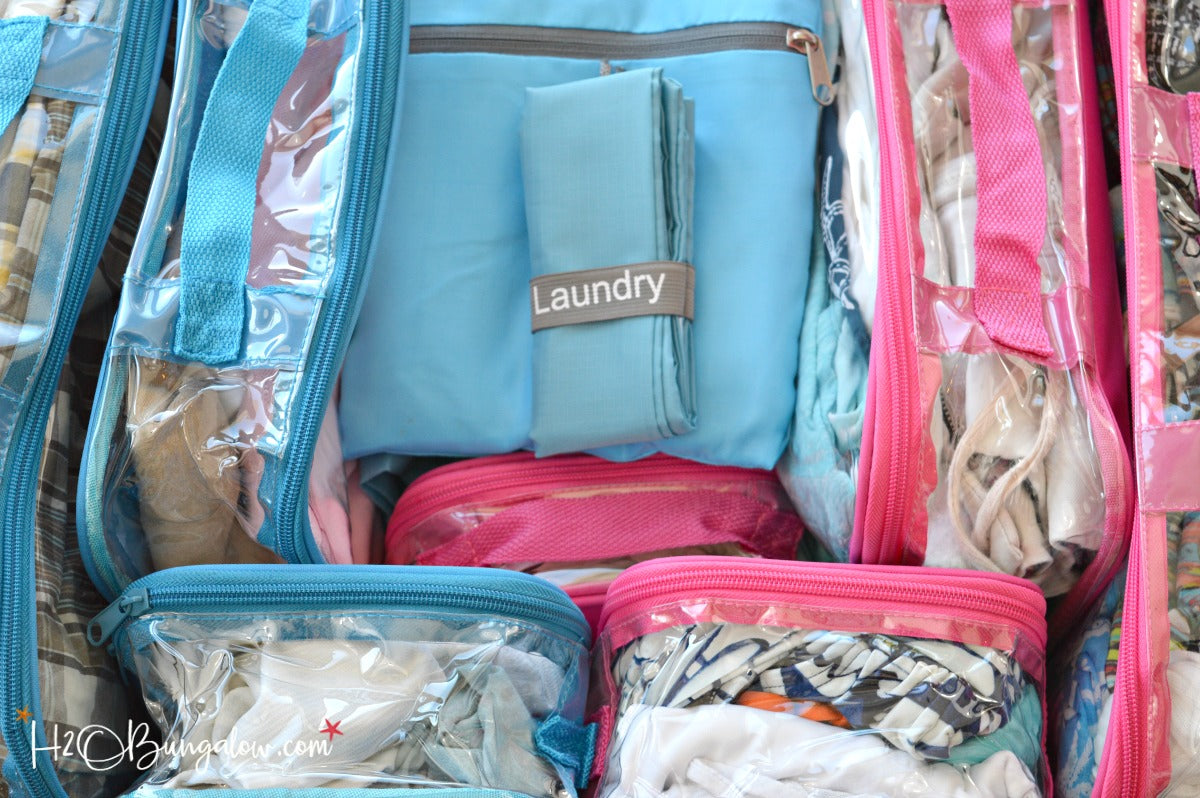 Travel laundry bag with clear packing cubes