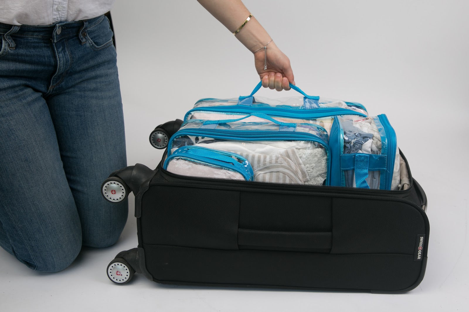 Turquoise packing cubes best system for carry on luggage