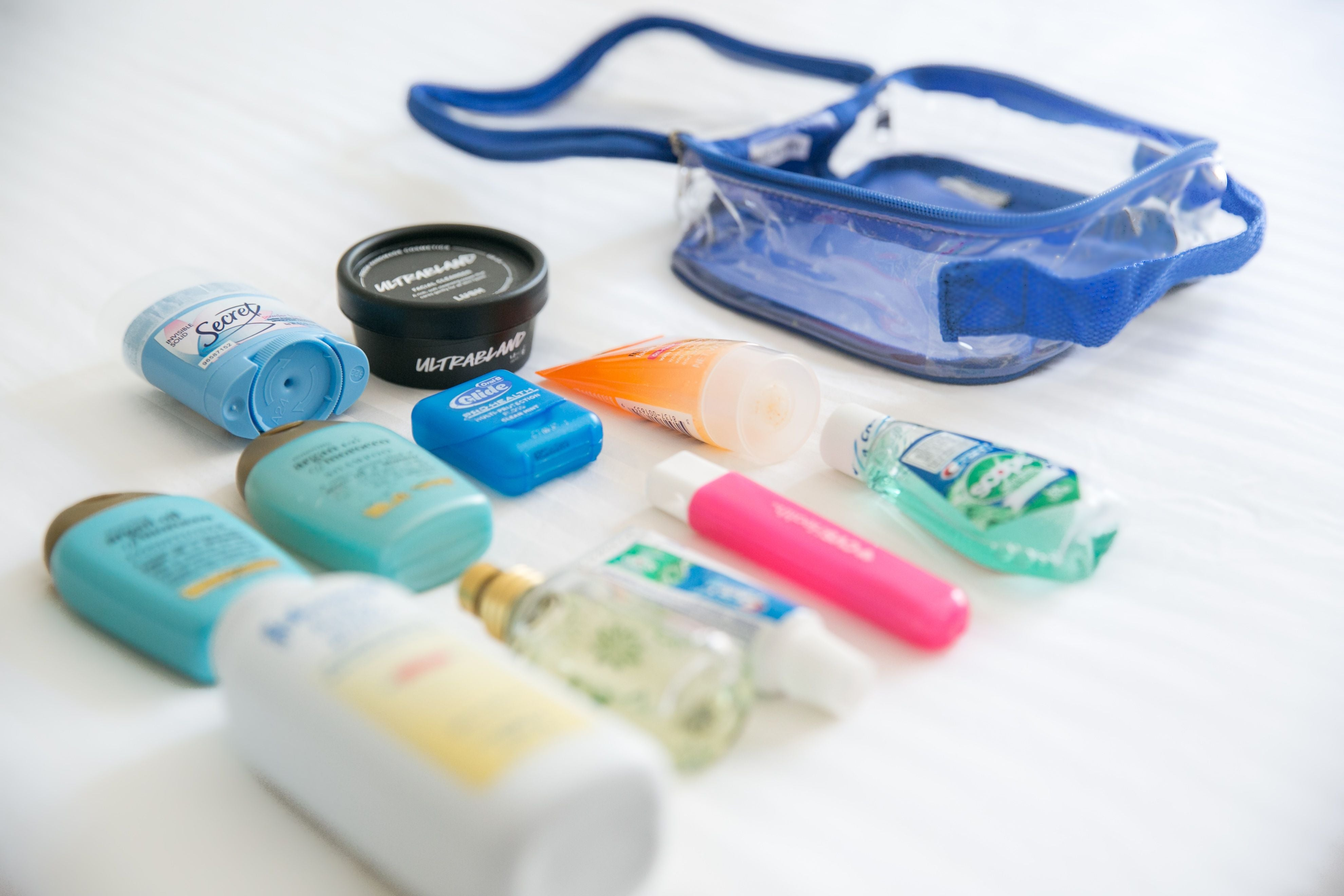 Unpacked travel size bottles and TSA approved toiletry bag