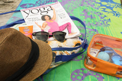 Use clear packing cubes to carry summer essentials at the beach like magazine, hat, sunglasses