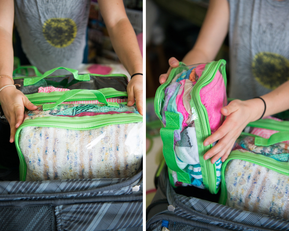 Packing cubes stacked vertically in suitcase