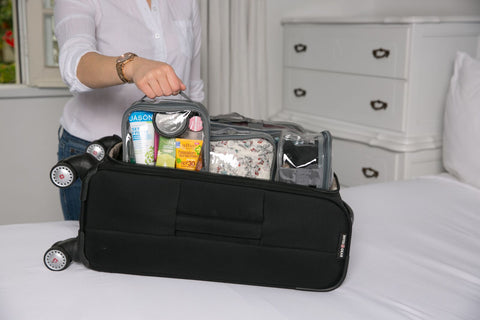 Woman stacking EzPacking cubes vertically to save space