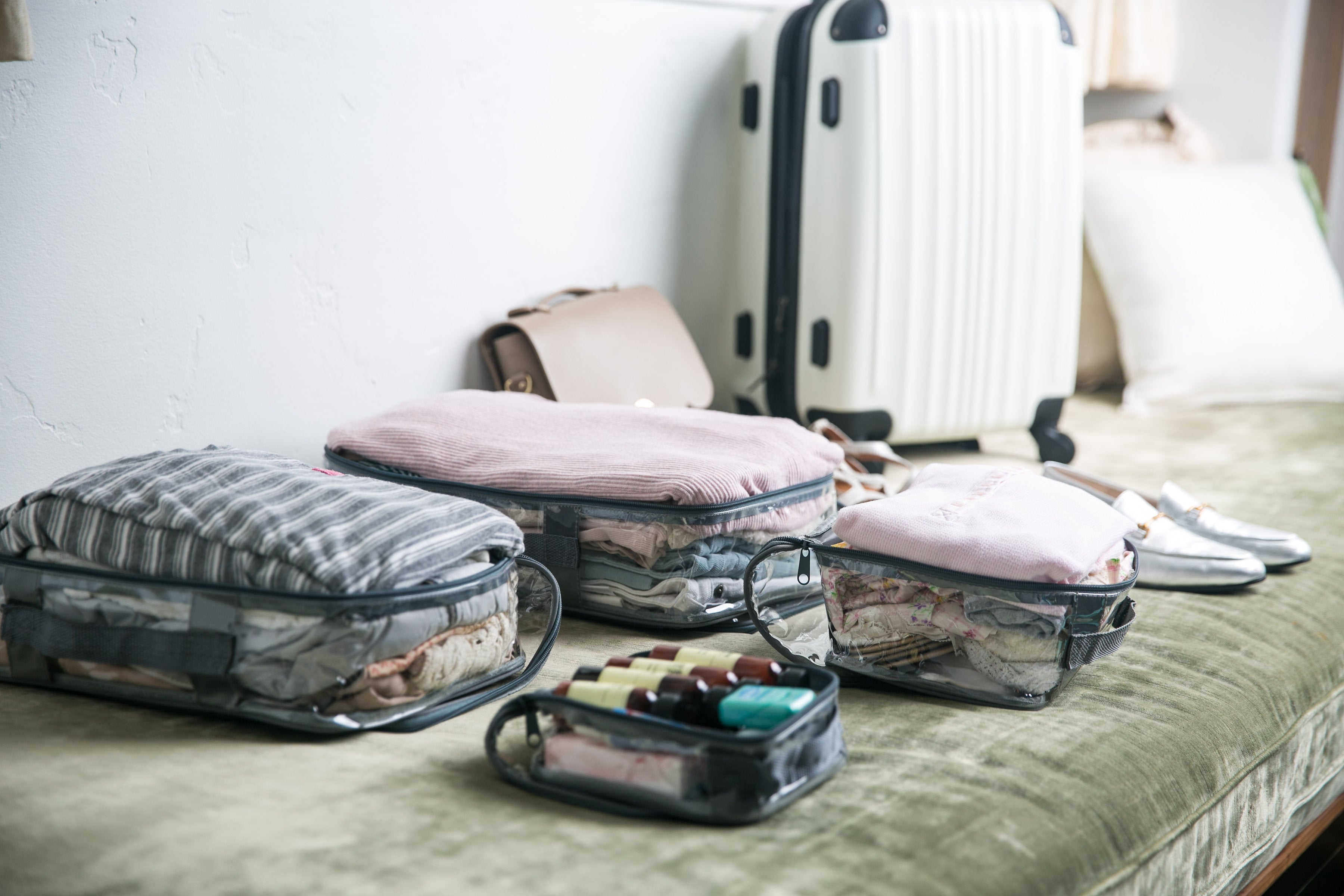 Different sizes of EzPacking cubes for an organized suitcase