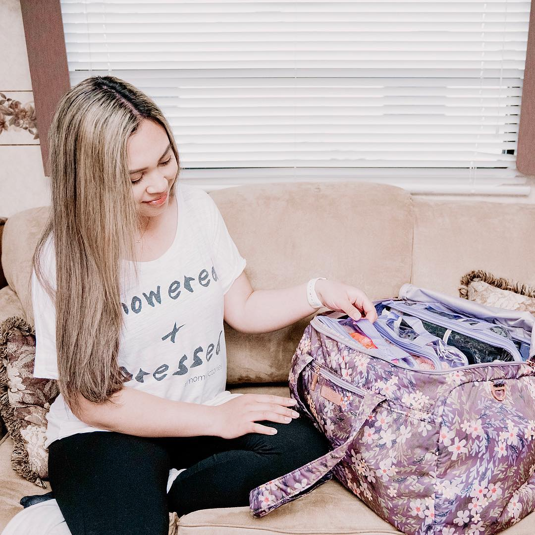 Young woman packing for an RV trip